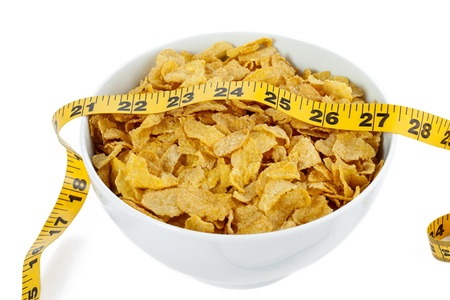 Closed up image of a bowl of corn cereals with tape measures on top Stock Photo - 17226580