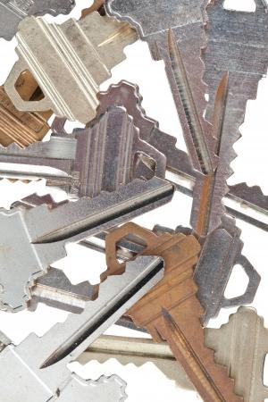 Detailed shot of various metallic keys on white. Stock Photo - 17227211