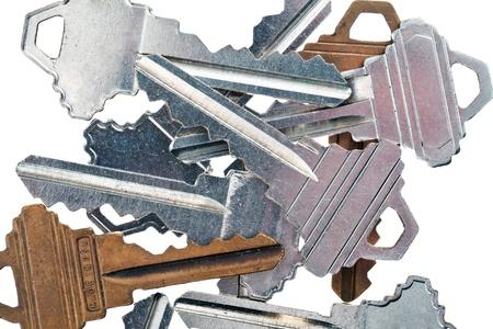 Detailed cropped image of old metallic keys on white background. Stock Photo - 17227212