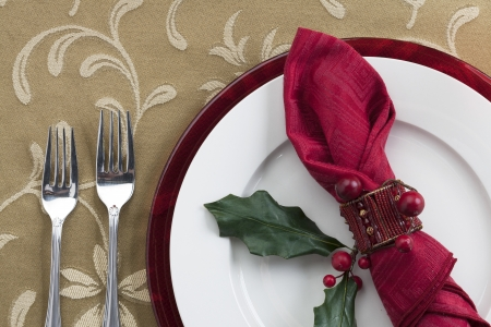 Close-up shot of dinner table with forks, plate and table cloth. Stock Photo - 17230565