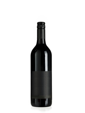 An empty bottle of red wine with a blank label