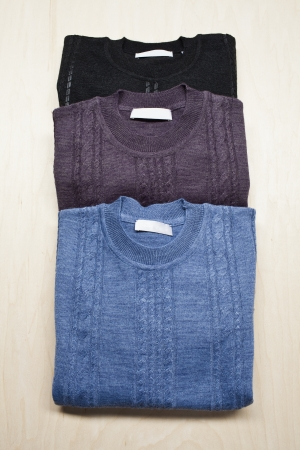 Sweaters arranged in a row. Stock Photo - 17230660