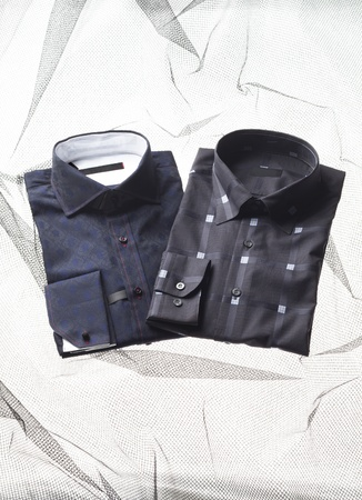 Image of two different's men shirts on bed Stock Photo - 17230575
