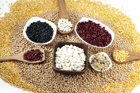 Various legumes and beans in a circle with kidney beans and chick-peas photo