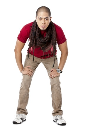 pinoy: Young asian man posing with hand on his knees Stock Photo