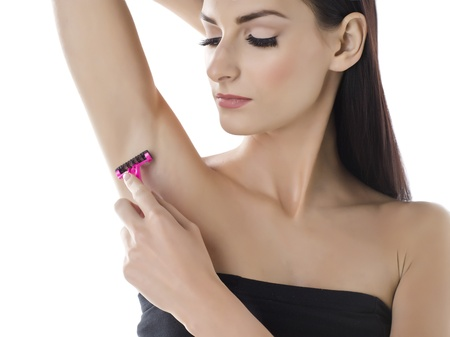 beautiful armpit: Close-up image a beautiful lady with pink shaver shaving her armpit