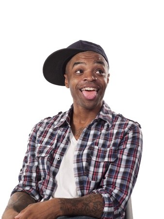 Portrait of a tongue out Black man on checkered photo