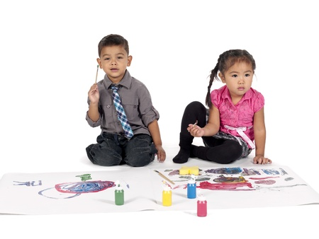 Cute little kids using paintbrush to draw on paper Stock Photo - 17245107
