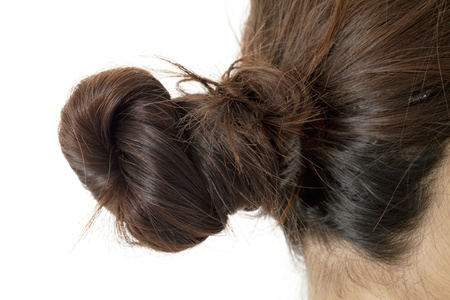 Woman with bun hairstyle in a macro image photo