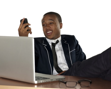 Close shot of a businessman on a cell phone while smiling . Stock Photo - 17244434