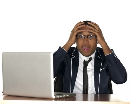 Young male professional looking worried and staring straight at the camera. Stock Photo - 17244432