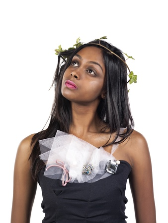 tradition: Thoughtful African American girl with laurel wreath on head isolated over white background Stock Photo