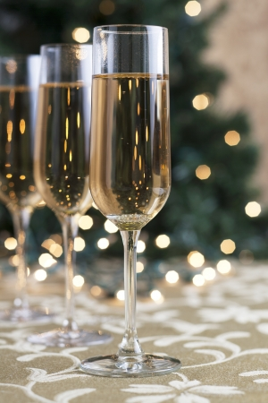 A portrait of three glasses of champagne on holiday season
