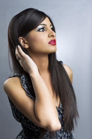 long nose: A beautiful Indian woman on a stolen image and gray background