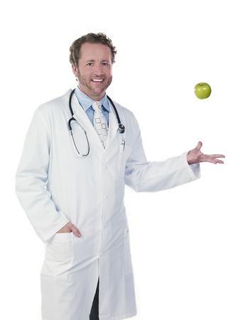Portrait of a doctor tossing green apple against white background, Model: Derek Gerhardt Stock Photo - 17244435