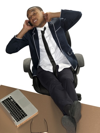Aerial view of businessman with his feet up and on the phone. Stock Photo - 17244449