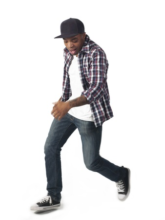 Portrait of black american young man dancing isolated on a white background photo