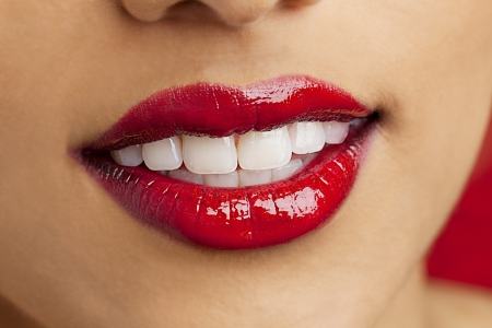 macro shot of a young Indian female wearing red lipstick, Kiran Bahugun Stock Photo - 17243826