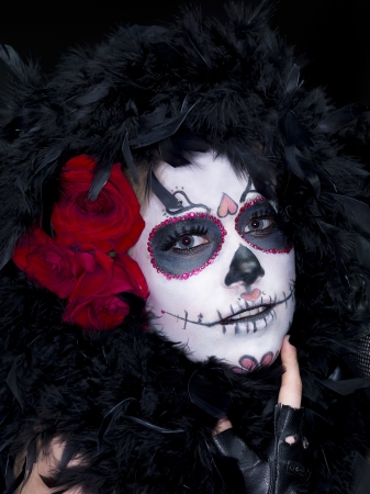christine: Close-up shot of a female wearing scary sugar skull make-up with fur and roses. Model: Christine Vandenberk