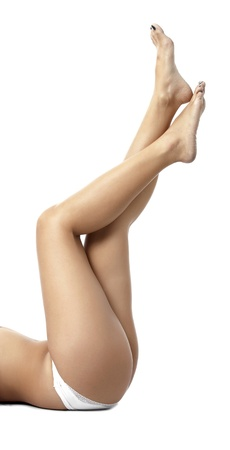 waxed: A close up image of  woman legs against white background