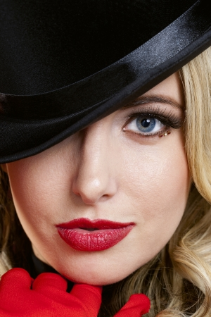 Portrait of a face of lady in a hat with red lips photo