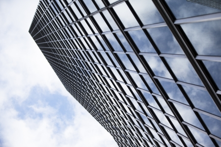 Low angle shot of reflection of clouds on office blocks against sky. Stock Photo - 17243815