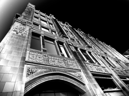 Low angle black and white stoned wall building at night. Stock Photo - 17243611