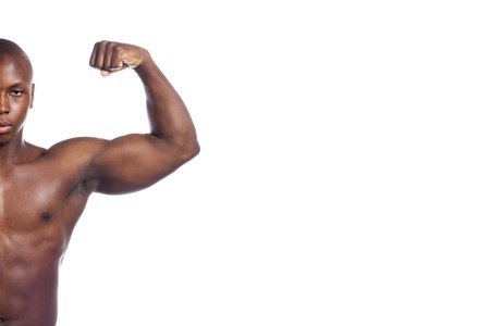 Man on a side flexing his left arm to show his muscle Stock Photo - 17245096