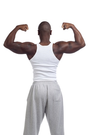 Model in a back view showing his biceps isolated on a white background Stock Photo - 17244447