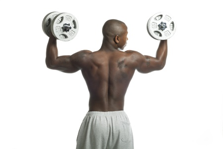 Rear view of a African American man lifting weights, Model: Gregory Dawson photo