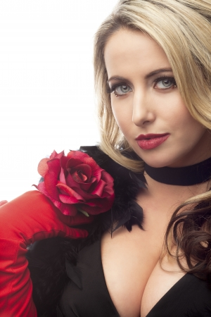 Portrait of a beautiful young woman holding rose over white background, Model: Nadine Yelovich