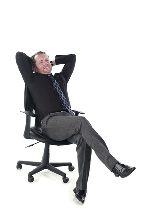 Portrait of a doctor relaxing on chair against white background, Model: Derek Gerhardt Stock Photo - 17244311
