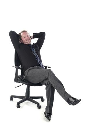 Portrait of a doctor relaxing on chair against white background, Model: Derek Gerhardt Stock Photo - 17244311