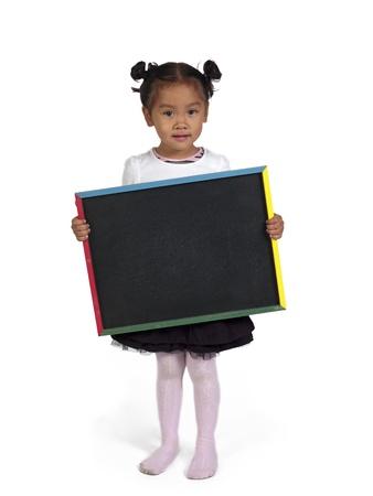 slateboard: Portrait of a little Asian girl holding chalkboard over white background,