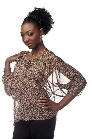 Portrait shot of a attractive African American woman posing with hand on hip and shoulder.