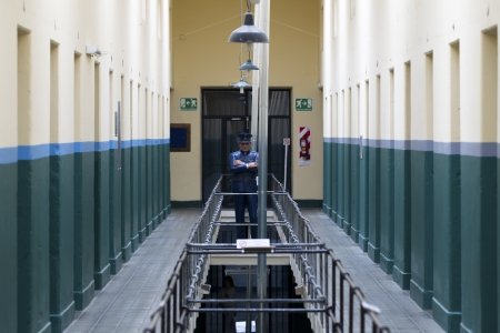 architectural feature: Image of a officers statue in a jailhouse.