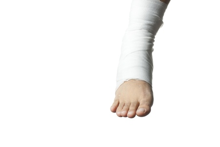 Close-up of white medicine bandage wrapped on human leg. photo