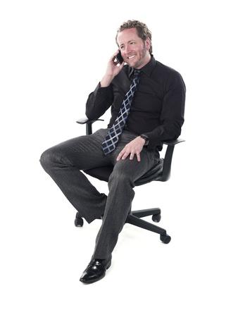Young doctor talking on cellphone against white background, Model: Derek Gerhardt Stock Photo - 17244318