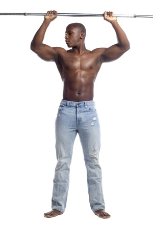 African American man exercising with a rod over white background, Model: Gregory Dawson