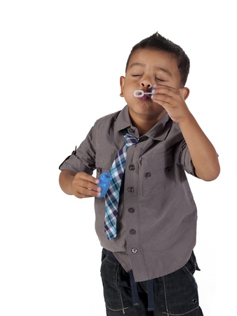Asian boy blowing bubbles over white background, Stock Photo - 17244698