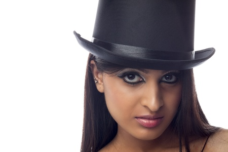 Portrait shot of a attractive young female wearing hat. photo