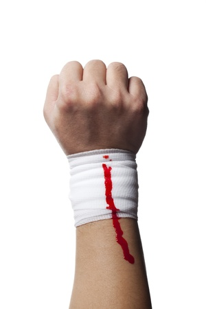 firstaid: Image of a bandage on a human hand with blood on it. Stock Photo