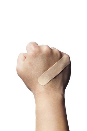 firstaid: Close-up shot de un vendaje en una mano humana.