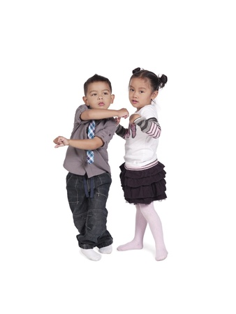 Image of two cute Asian kids isolated on white background, Model: Jaedyn Fulay, Kai Wall Stock Photo - 17244669