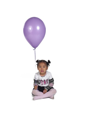 Cute little Asian girl holding balloon over white background, Stock Photo - 17244666