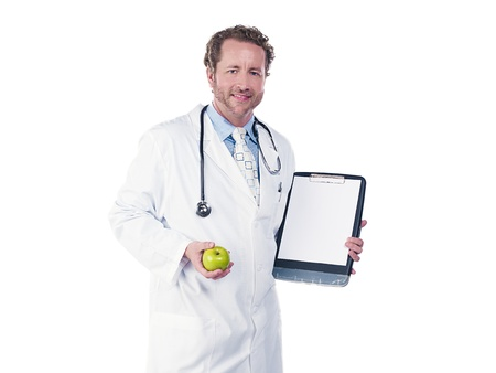 Portrait of a young doctor holding green apple and clipboard, Model: Derek Gerhardt Stock Photo - 17244309