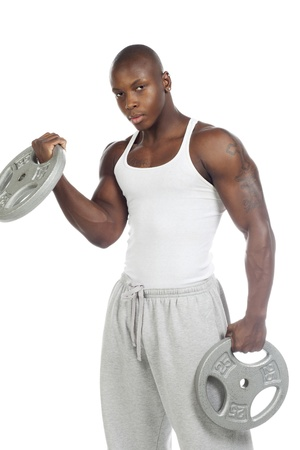 Portrait shot of a African-American man with weight disk against white background. Model: Gregory Dawson photo