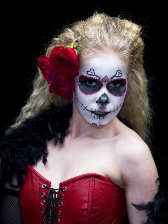 Portrait image of a scary woman wearing face make-up and roses over dark background. Model: Christine Vandenberk Banco de Imagens