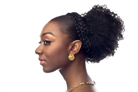 Profile head shot of a attractive African American young female in make up and earring and necklace.
