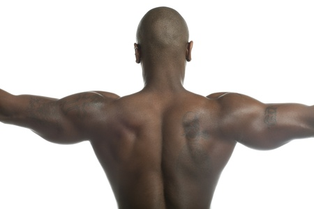 Close-up rear view of a bald shirtless man flexing muscles over plain white background. Model: Gregory Dawson photo
